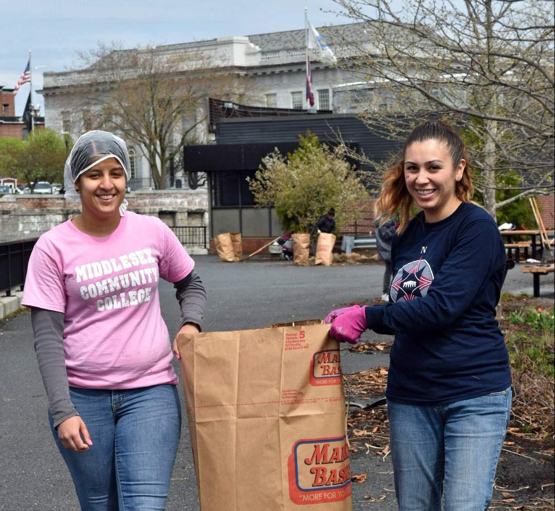 Middlesex Community College volunteers working along the Concord River Greenway.