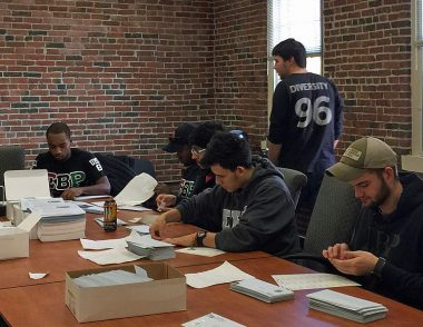UMass Lowell Fraternity, Sigma Beta Rho, assembling a mailing at the Trust office.