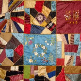 A 'crazy quilt' from 1845 hanging in the Spalding House (photo courtesy of Barbara Poole)