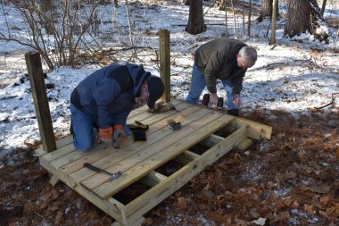 Corporate volunteers from Constellation, an Exelon Company, constructing a viewing platform.