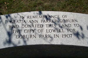 A bench with an engraved dedication to the Coburn family.