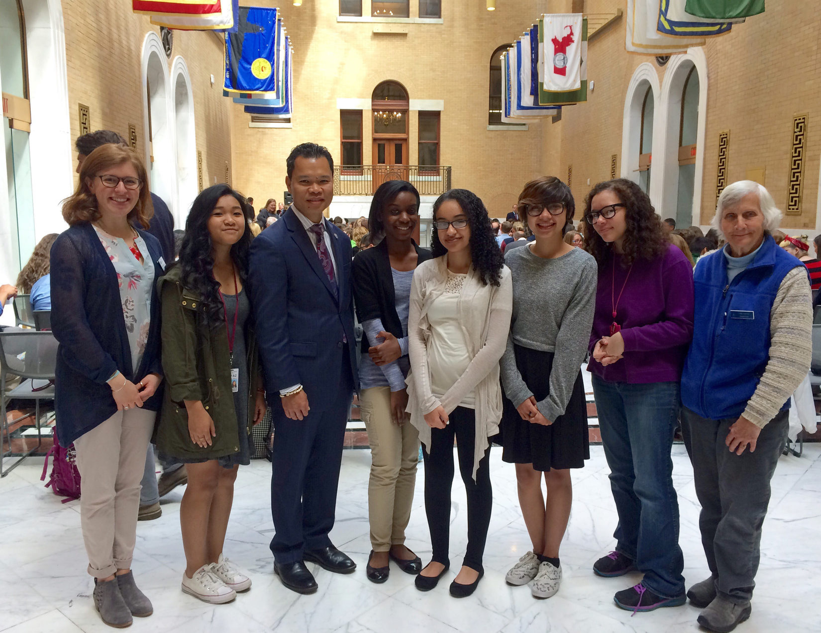 LLIS Students with Representative Rady Mom before receiving the Secretary's Award for Excellence at the State House.